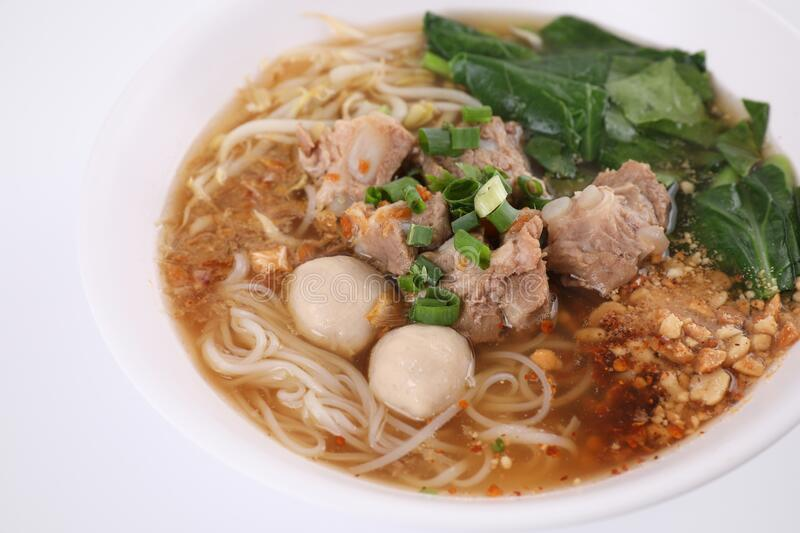 Local Thai food , Noodle with meat ball and pork isolated in white background royalty free stock photos