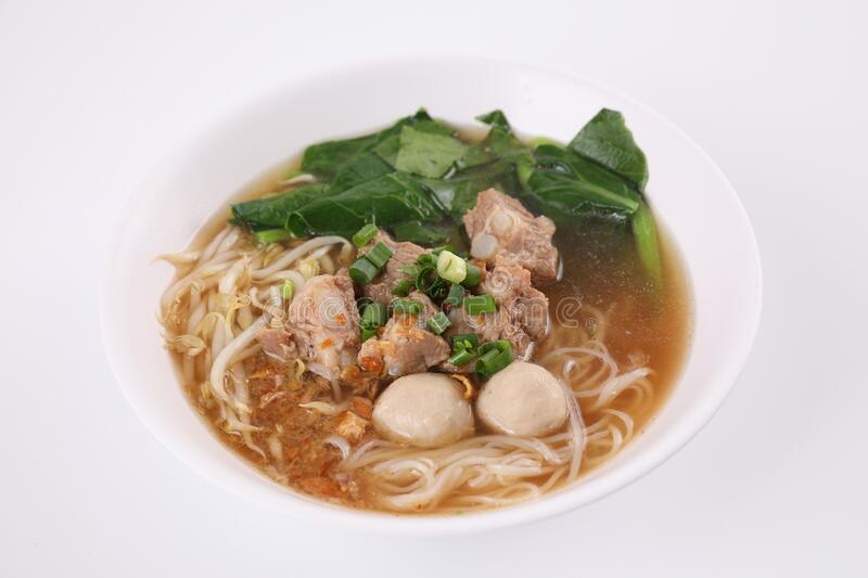 Local Thai food , Noodle with meat ball and pork isolated in white background royalty free stock images