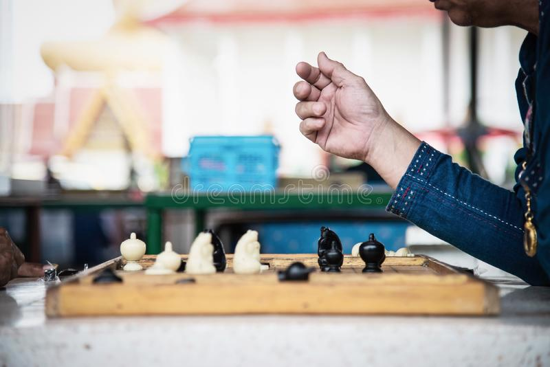 Local Thai people play old traditional Thai chess in public area stock images