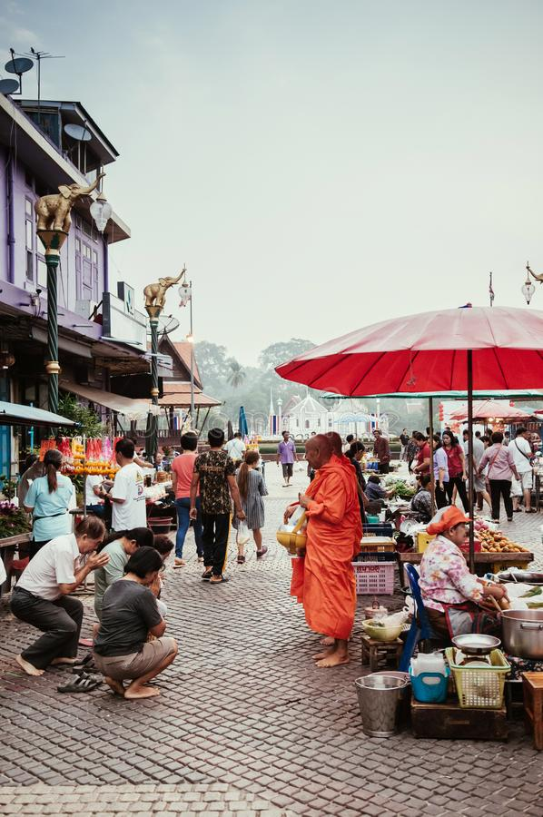 Local Thailand morning market Buyers and sellers and people offering food to monks stock image