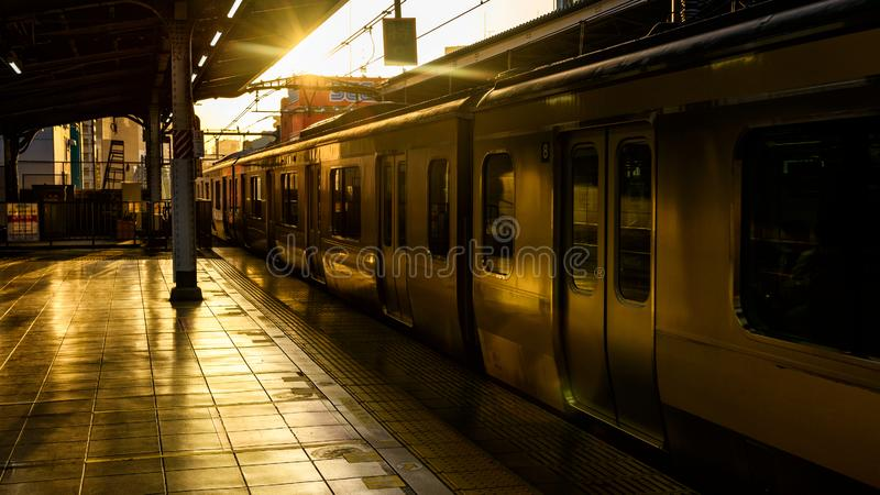 Local Tokyo JR train in city at sunset stock photos