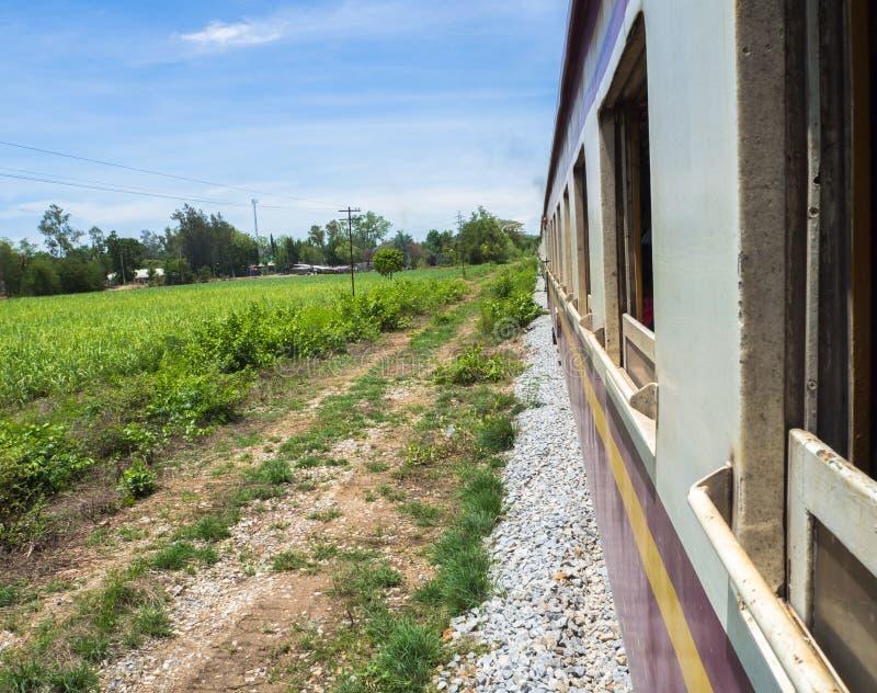 Local train run passes the agriculture farm stock photo