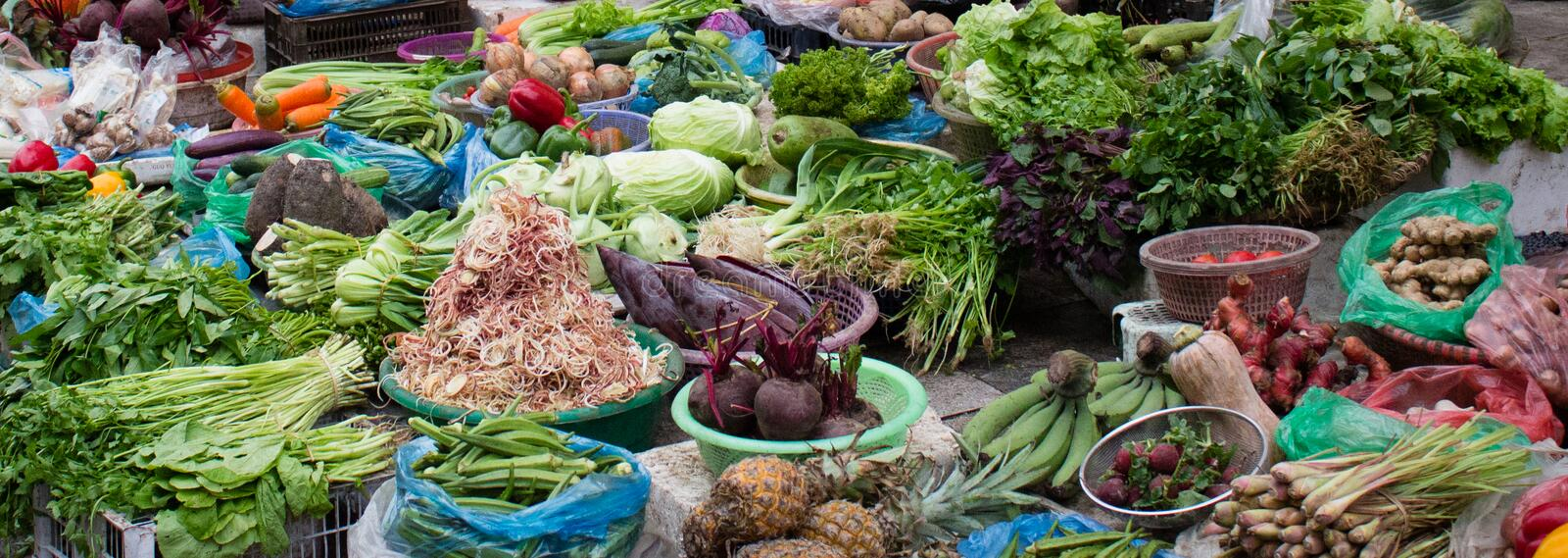 Local vegetable and fruit shop on the ground in local market royalty free stock photo