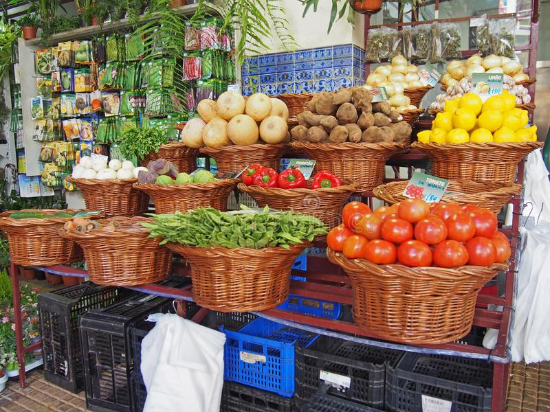 local vegetables in baskets on a stall in the covered market in funchal madeira royalty free stock images