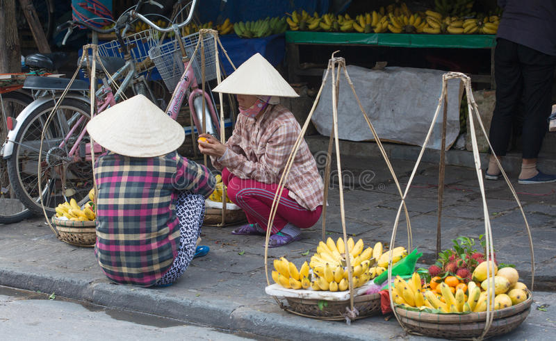 Local Vietnamese women street vendors. In Hoi An, Vietnam. Hoi An is the renown of World heritage cultural site stock image