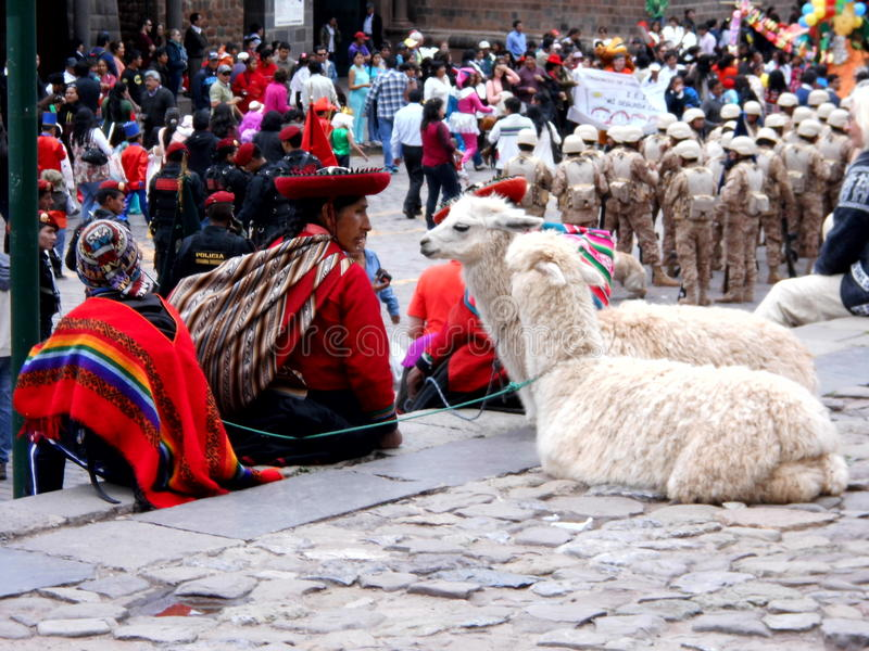 Local woman Knitting in the street is representing the local tradition in Cuzco royalty free stock image