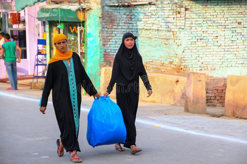 Local women walking in Taj Ganj neighborhood of Agra, Uttar Pradesh, India. Agra is one of the most populous cities in Uttar Pradesh stock photography