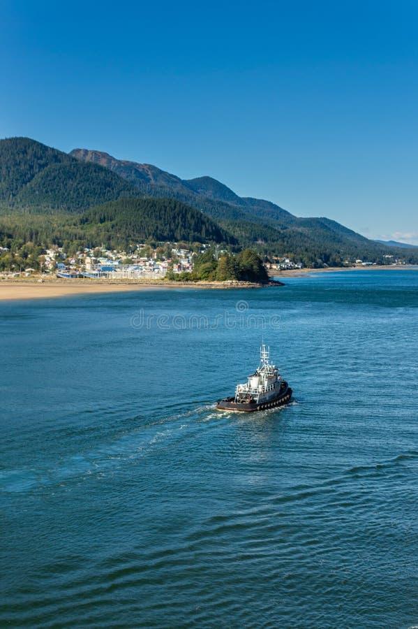 Local tugboat heading North, Gastineau Channel, Juneau, Alaska, USA. stock photography