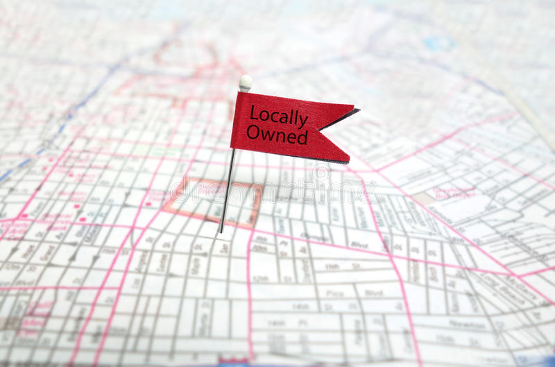 Locally Owned. Pin flag on map royalty free stock photo