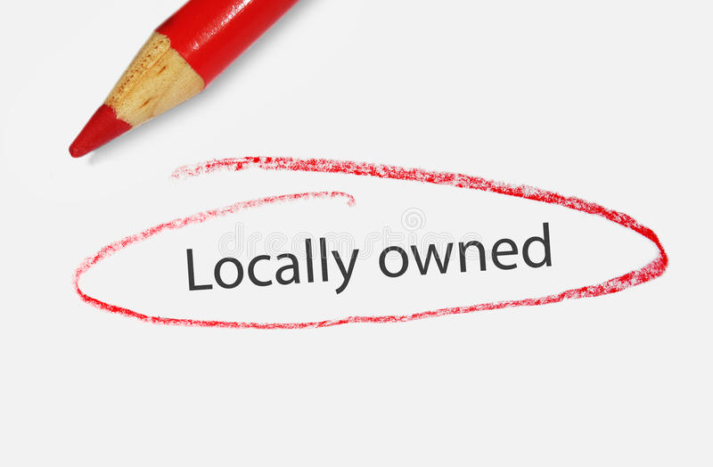 Locally owned. Text circled in red pencil - small business concept royalty free stock photos