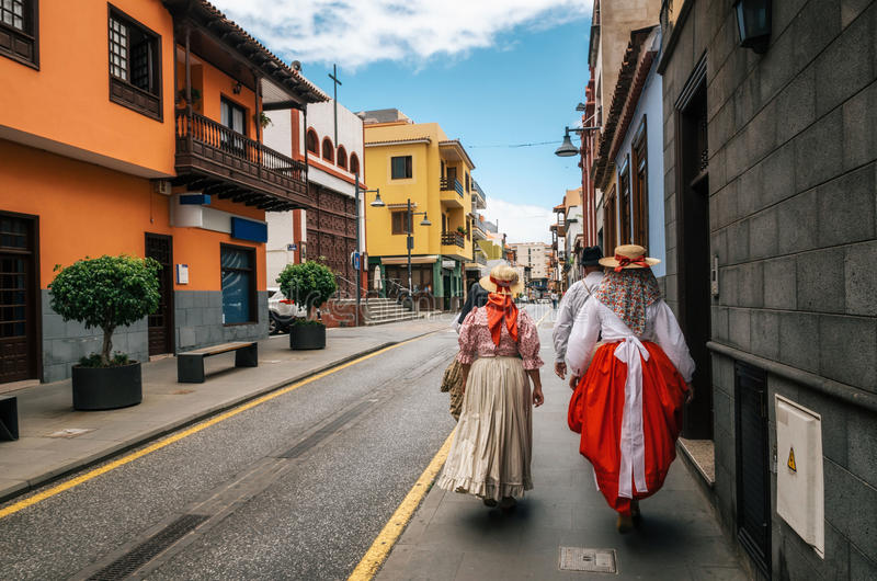 Locals in Canarian traditional clothes walk along the street of Puerto de la Cruz. Day of Canary Islands. Tenerife. A group of locals in Canarian traditional royalty free stock photos