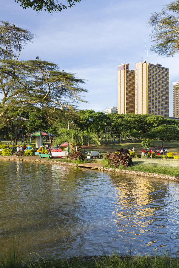 Download Locals Enjoying The Evening In Uhuru Park In Nairobi, Kenya Stock Photo - Image: 83700572