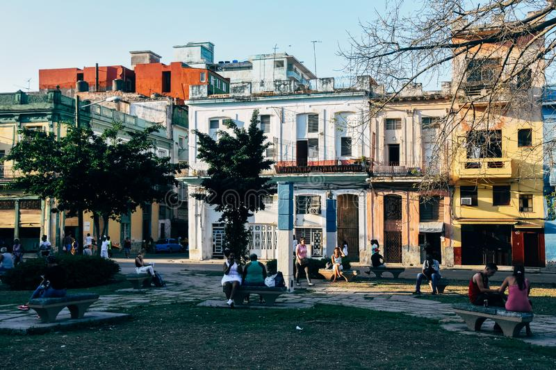 Locals sitting in the shade in Havana, Cuba. Locals gathering and sitting in the shade in Havana, Cuba royalty free stock image