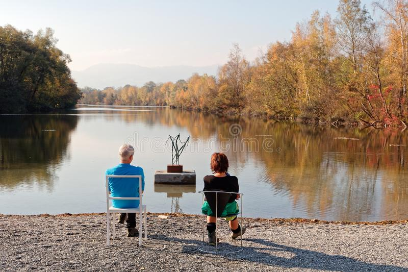 Locals resting at banks of Old Rhine royalty free stock images