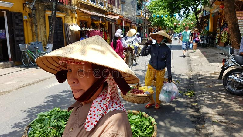 Locals on street in Hoi An Vietnam stock images