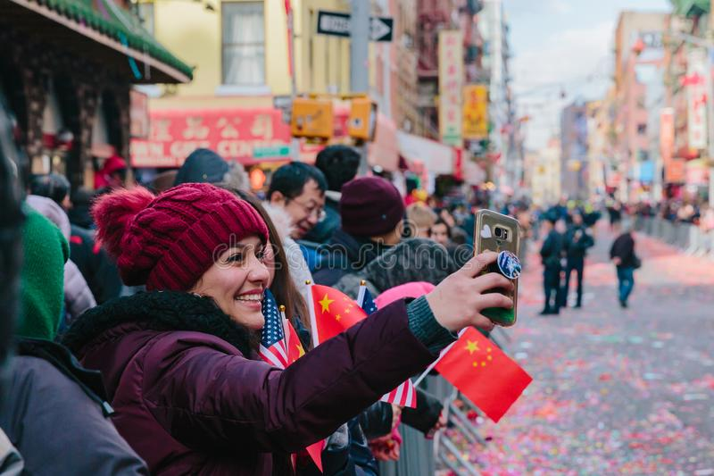 Locals taking selfies at Lunar New Year Parade in Chinatown, Manhattan stock image