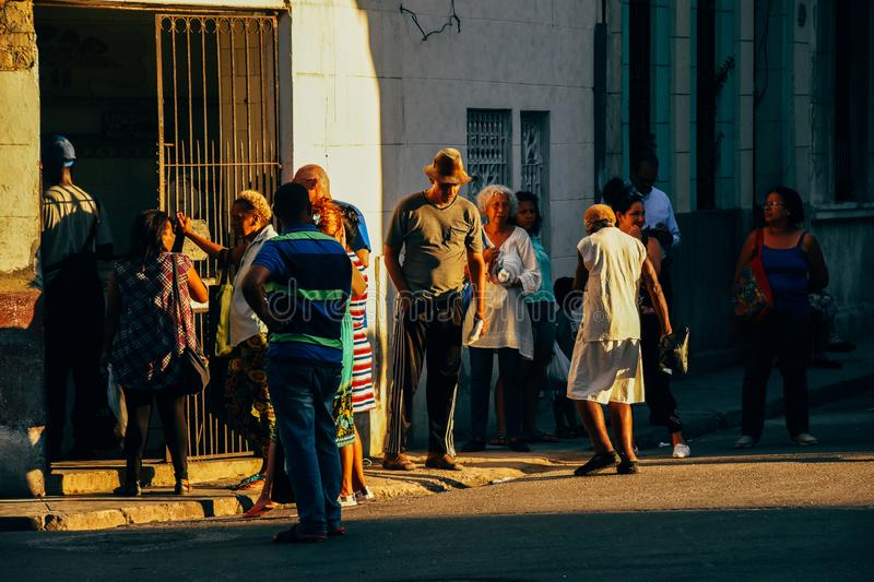 Locals waiting in the late sun in Havana, Cuba. Locals waiting in the late winter sun in Havana, Cuba royalty free stock photo