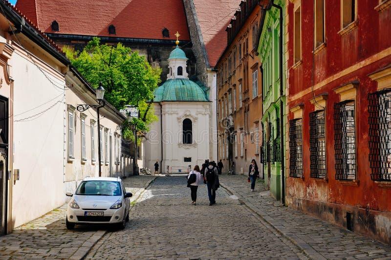 Locals walk in Old Bratislava, Slovakia. Locals walking the back streets in Old Bratislava, Slovakia stock image
