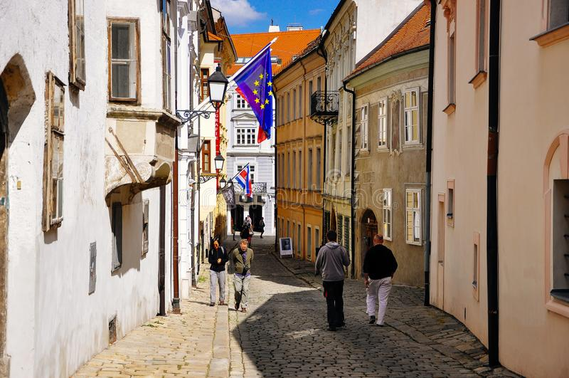 Locals walk in Old Bratislava, Slovakia. Locals walking the back streets in Old Bratislava, Slovakia stock photos
