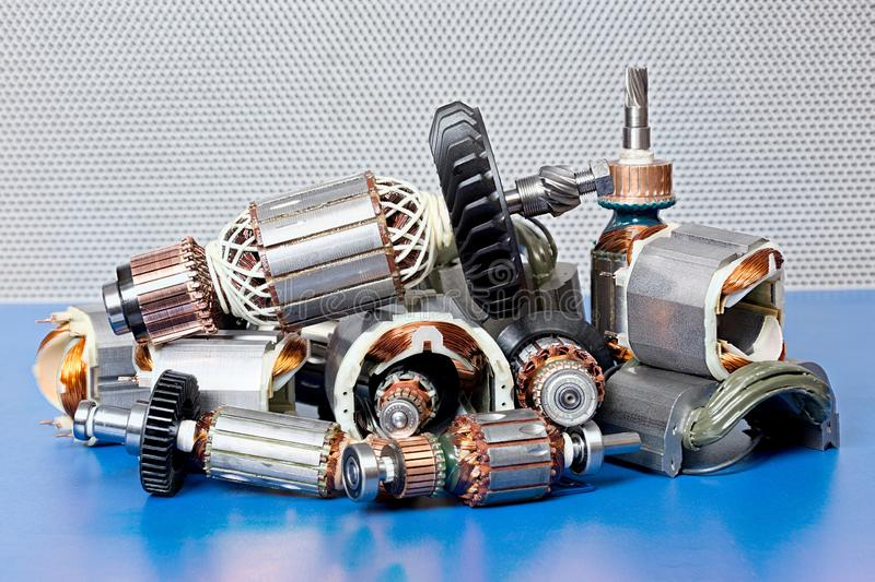 Located on a blue background variety of bearings and rollers. High resolution photo stock photography