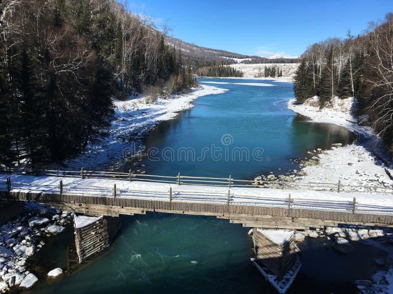 Snowy Bridge in Hemu village in Xinjiang, China. Located within the Kanas Lake scenic area in the north of China`s Xinjiang Uygur autonomous region, Hemu is a royalty free stock photo