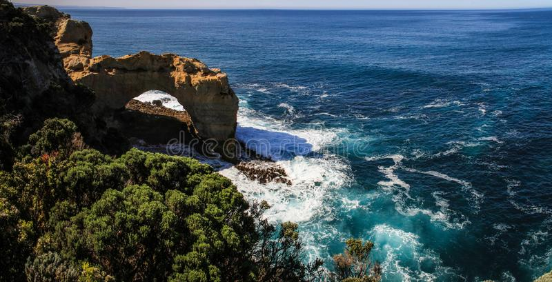 The Arch, Port Campbell, Great Ocean Road, Victoria, Australia. Located 6km west of Port Campbell this naturally sculptured arch stands at 8 metres high. The royalty free stock photography