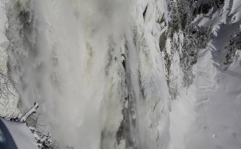 Water Plunges Over Montmorency Falls. Located 15 minutes from Old Quebec, the Montmorency Falls Park is a spectacular historic site. The falls dominate the stock images