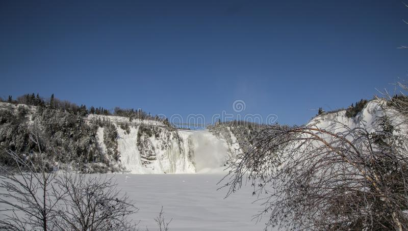 Frozen Wonderland--Montmorency Falls in the Winter. Located 15 minutes from Old Quebec, the Montmorency Falls Park is a spectacular historic site. The falls stock photos