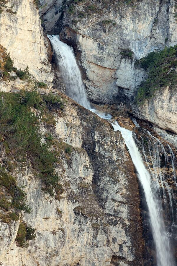Fanes Waterfall in the Dolomites, in a sunny autumn day. royalty free stock photo