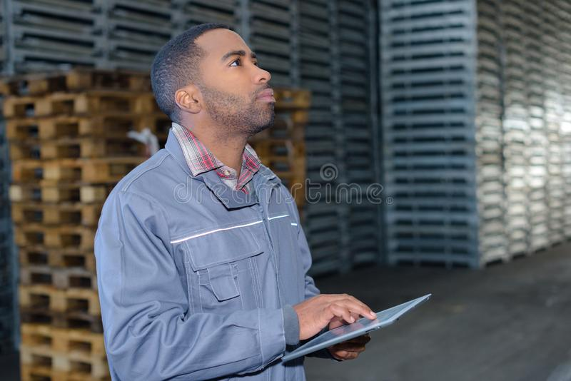 He locating product. He is locating a product stock photos