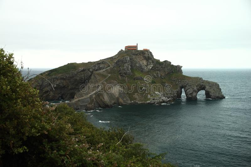 The location of Rocadragon. Game of Thrones. The location of Rocadragon in the 7th season of Game of Thrones is San Juan de Gaztelugatxe, in the municipality of royalty free stock photography
