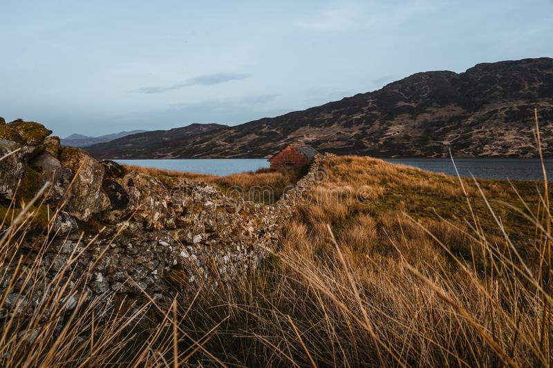 Cottage at loch arklet in Scotland royalty free stock photo
