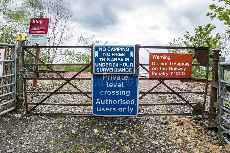 Loch Awe, Argyll , Scotland - May 15 2017 : Sign with instructions how to tresspass the railway. LOCH AWE, ARGYLL, Scotland - MAY 15 2017 : Sign with stock photo