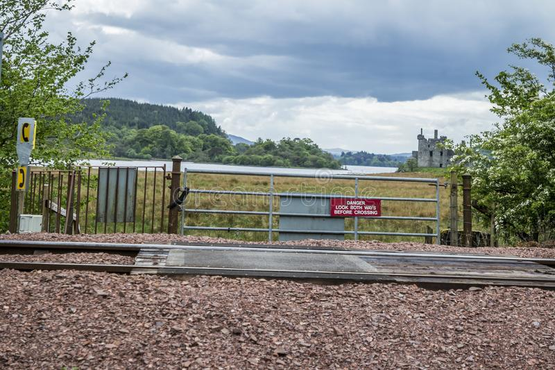 Loch Awe, Argyll , Scotland - May 15 2017 : Sign with instructions how to tresspass the railway. LOCH AWE, ARGYLL, Scotland - MAY 15 2017 : Sign with royalty free stock images