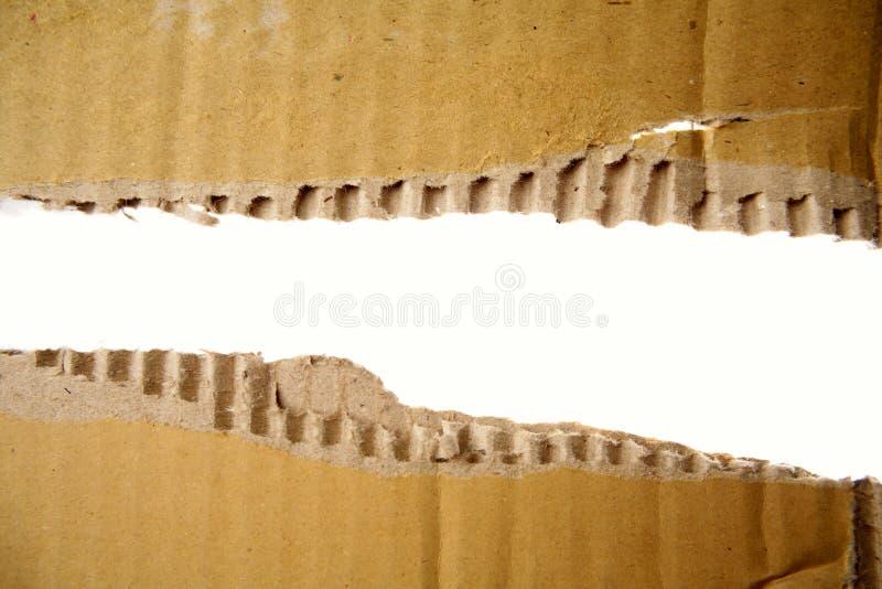 Loch in der Pappe stockbild