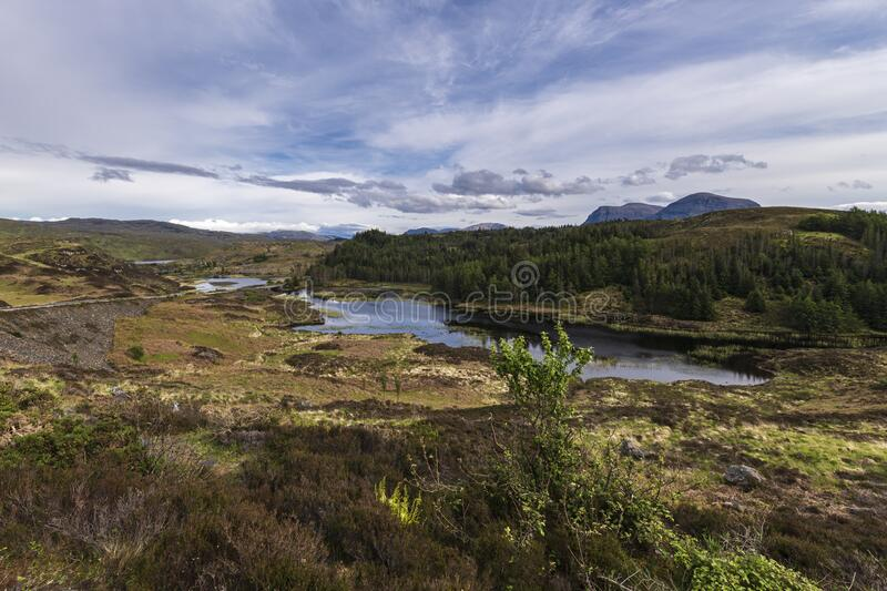 Loch Duartmore. Assynt, Sutherland, Scottish Highlands, with Quinag jin the distance. Part of the scenery of the North Coast 500 route stock image