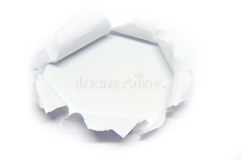Loch im Papier mit heftiger Seite stockbild