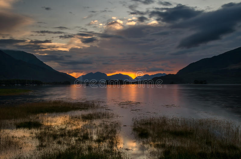 Loch Leven. In Glencoe with colorful sunset in background, Highland, Scotland stock images
