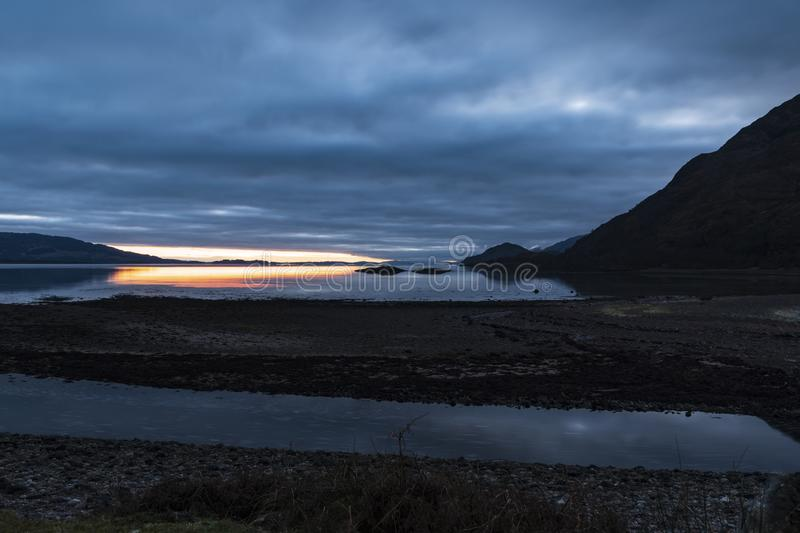 Loch Linnhe Evening. A sunset over Loch Linnhe near the corran narrows and Ardgour, Lochaber, Scotland royalty free stock image