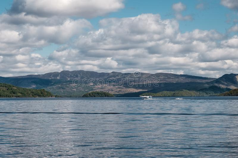 Seaplane taking off from Loch Lomond in Scotland stock images
