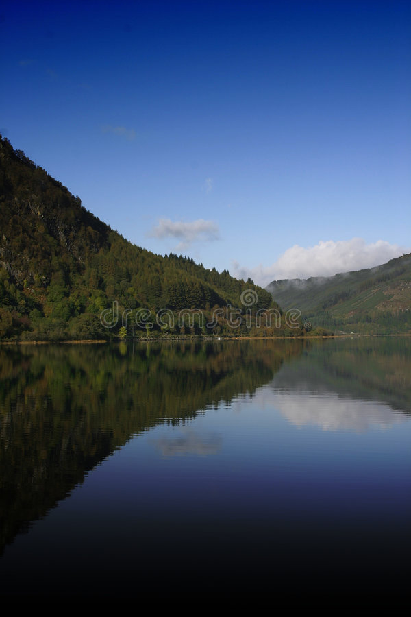 Loch Lubnaig. A shot of Loch Lubnaig in Scotland. The Loch had almost settled to a very still state stock images