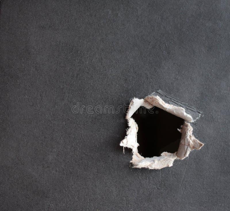 Loch mit den fragmentarischen Rändern stockfotografie