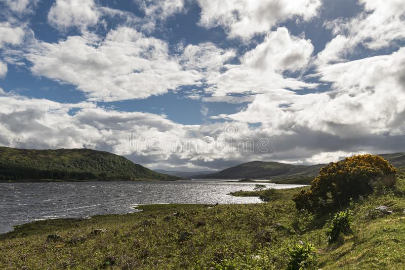 Loch Naver. On a breezy summer afternoon with bright sunlight through the clouds, Strathnaver, Sutherland, Scotland royalty free stock photography
