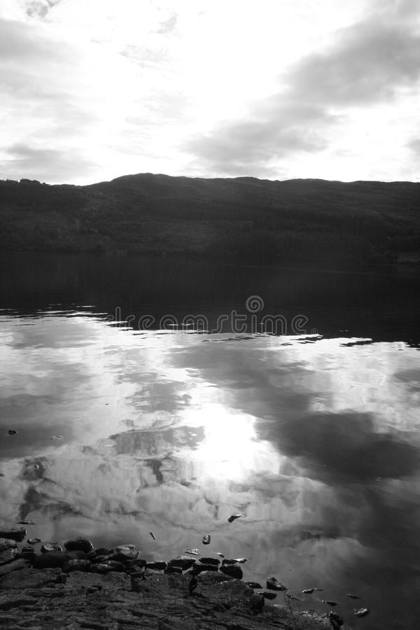 Loch Ness in black & white - II. Black & white shot of Loch Ness, on a cloudy September day. Scotland. UK. View from Fort Augustus harbour stock photography