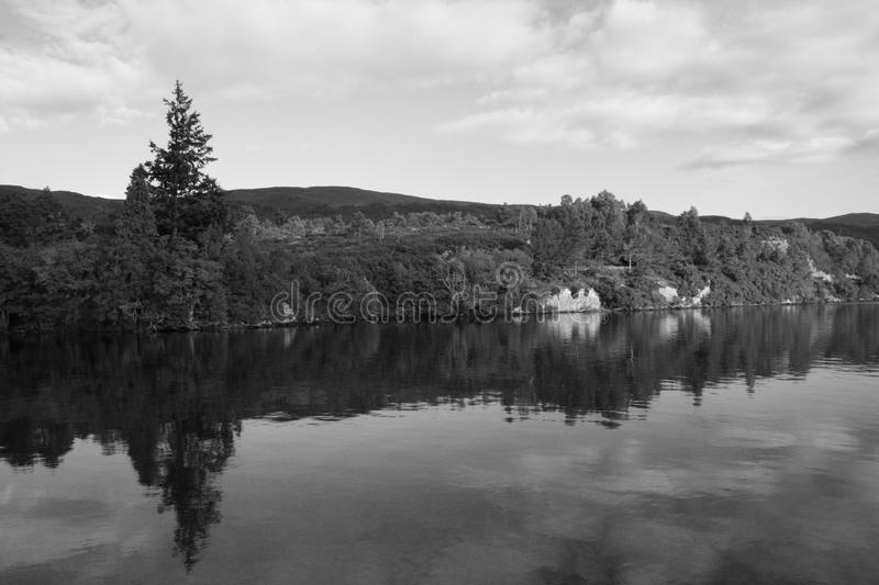 Loch Ness in black & white - III. Black & white shot of Loch Ness, on a cloudy September day. Scotland. UK. View from Fort Augustus harbour royalty free stock photography