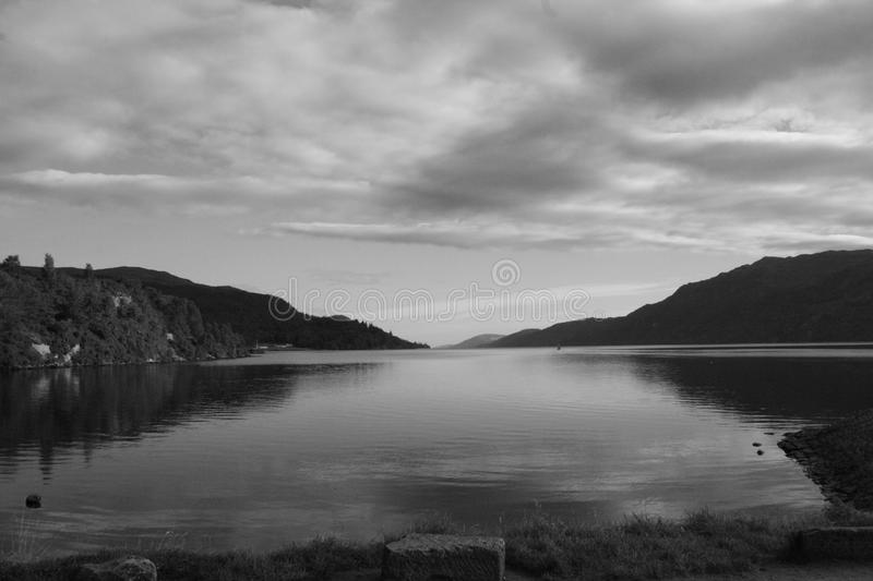 Loch Ness in black & white. Black & white shot of Loch Ness, on a cloudy September day. Scotland. UK. View from Fort Augustus harbour royalty free stock images