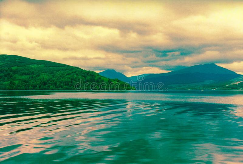Beautiful Loch Ness. Loch Ness or lake Ness is a mysterious and yet beautiful place in Scotland. The beauty of the nature, great landscape with moody sky, clouds stock photography