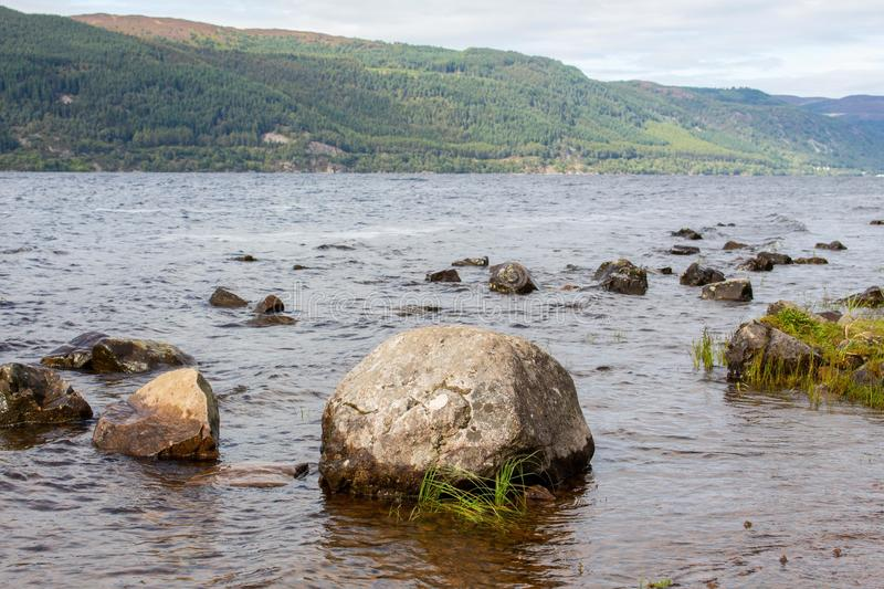 Loch Ness Loch in Scotland. Loch Ness is a large, deep, freshwater loch in the Scottish Highlands extending for approximately 37 kilometres southwest of stock photo