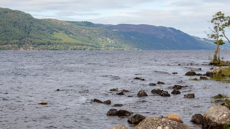 Loch Ness Loch in Scotland. Loch Ness is a large, deep, freshwater loch in the Scottish Highlands extending for approximately 37 kilometres southwest of royalty free stock photos