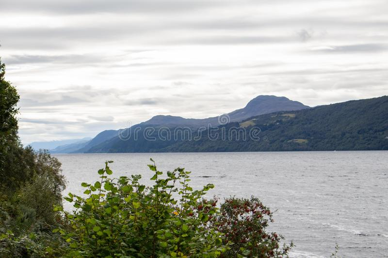 Loch Ness Loch in Scotland. Loch Ness is a large, deep, freshwater loch in the Scottish Highlands extending for approximately 37 kilometres southwest of royalty free stock image